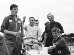 Jim waves to the crowd before donning the pullover. From left to right: Dougie Bridge, Jim, Willie Cowe, Leo Wybrott, Colin Chapman and Dick Scammell